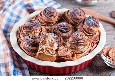 Yeast Rolls With Cinnamon Decorated With Sugar Powder. Sweet Food