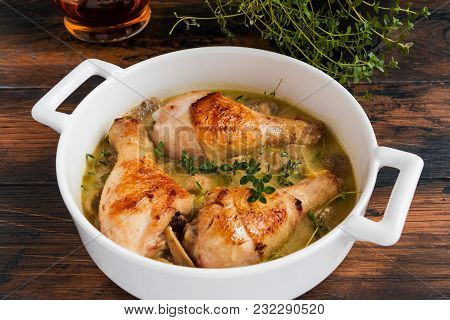 Chicken Drumsticks Baked With Mustard And Sour Cream Sauce With Champignons And Fresh Thyme In A Whi