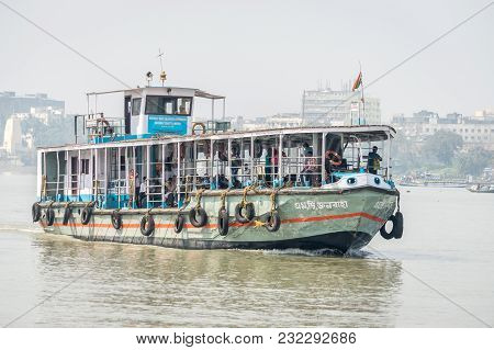 Kolkata, India - 4 March 2018:  An Isolated View Of A Ferry Crossing River Ganges Or Ganga With Comm