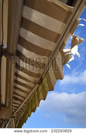 Broken White And Brown Awning, Damaged Canvas Shading Need To Replace