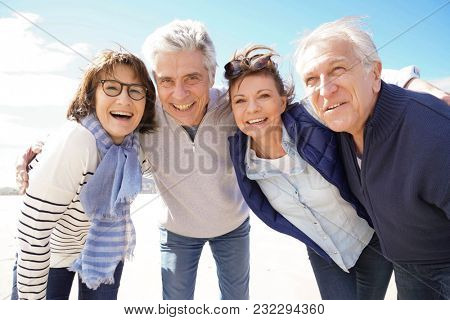 Portrait of cheerful senior people having fun on vacation
