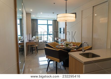 Comfortable Main Room Of Studio Flat With Dining Table Prepared For Japanese Cuisine. Modern Apartme