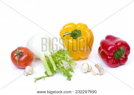 Red Pepper With Yellow Pepper And Tomatoes On White Background.vegetables In Composition On A White