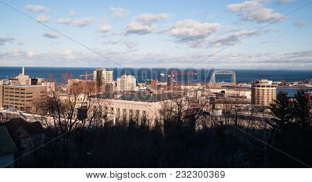 The City Skyline Rises Up From The Tree Branches On A Cold Winter Day In Duluth Mn