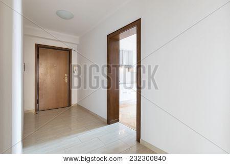 Empty entrance, clean white walls