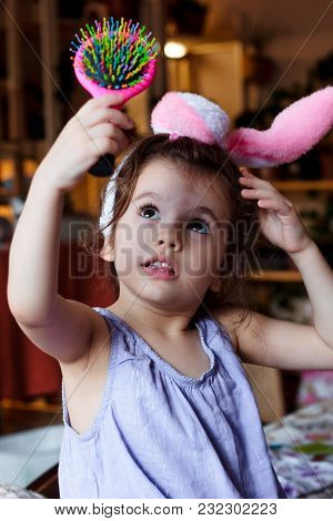 Little Kid Girl Having Fun With Bunny Ears On Head