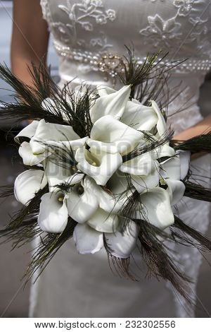 Wedding Bouquet From White Callas And Peacock Feathers