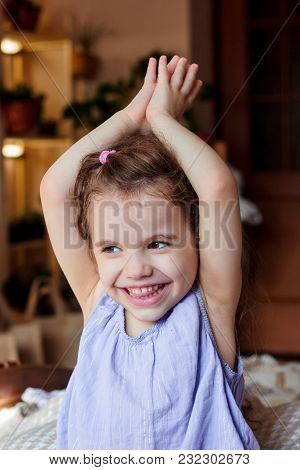 Little Kid Girl Smiling And Holding Hands In Namaste