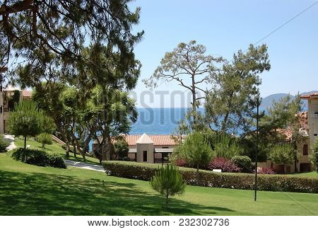 Oludeniz, Turkey - May 27, 2011: View Of The Green Territory, Pines And The Blue Sea In The Hotel Li