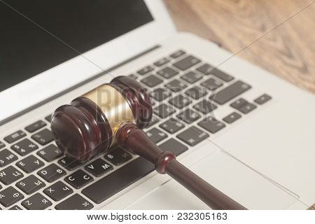 Judge Gavel With Laptop Computer On Wooden Background