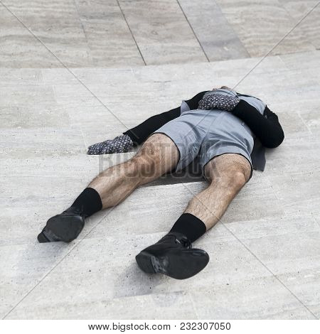 Man In Shorts Laying On A Staircase