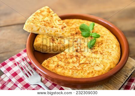 Traditional Spanish Omelette Close Up,  View From Above. Spanish Tortilla On A Rustic Wooden Texture
