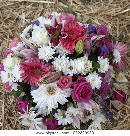 Wedding Bouquet From Chrysanthemum, Gerbera, Roses, Bells, Lily, Daisy Lying On