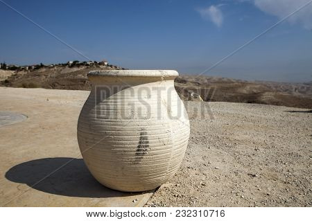 Vase In Front Of View Of Sands Of Judean Desert In Israel, From A Hill