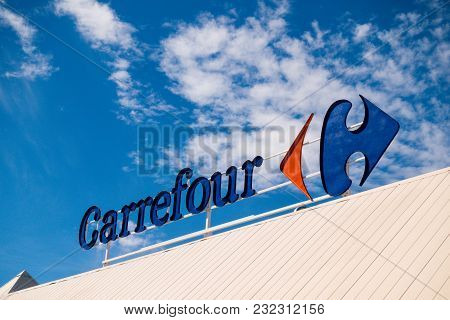 Finestrat, Spain - March 9, 2018: Carrefour Logo Over Blue Sky Background.