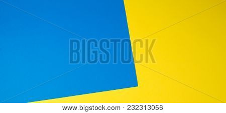 Color Papers Geometry Flat Composition Banner Background With Yellow And Blue Tones.