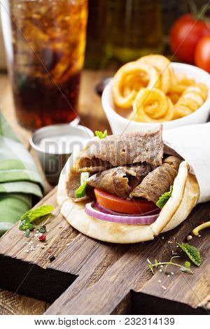 Greek Gyro Pita Wrap With Curly Fries