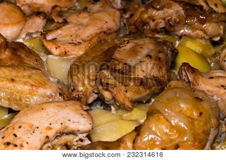 Potato With A Hen On Grill .whole Roast Chicken.