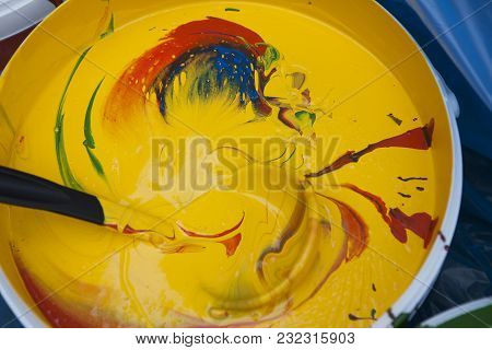 The Paint Buckets With Yellow And Red Colors