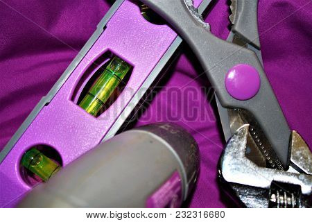 Purple Accented Tools On A Purple Background