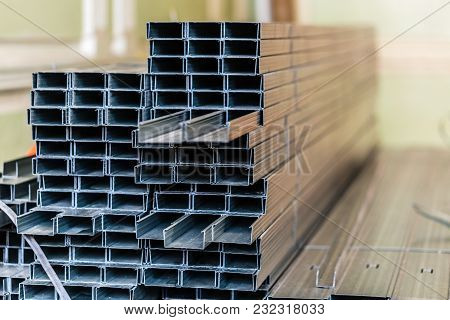 Frames For Plasterboard Metal Profiles For Drywall Are Being Prepared For Making Gypsum Walls By Wor