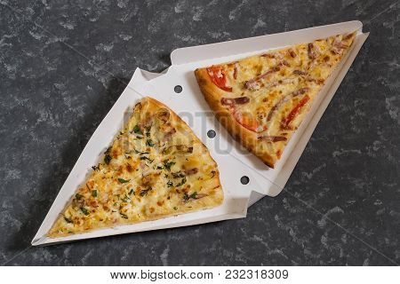 Two Pieces Of Delicious Pizza In Box For Delivery On Gray Textured Background. Pizza On Order. Two S