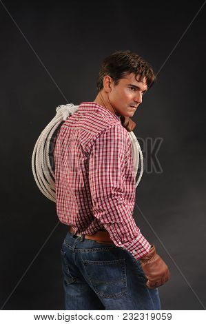 The Sexy Cowboy Awaits His Pretty Lady.