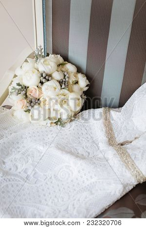 Bridal White Dress And Bouquet On Vintage Striped Chair. Bridal Room Interior. Wedding Style.