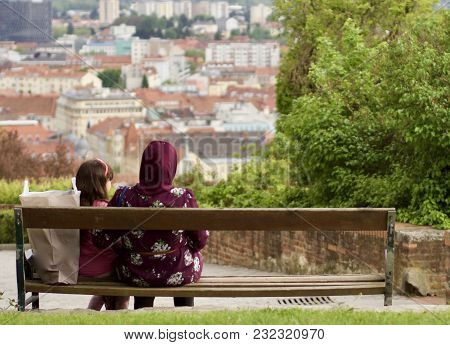 Muslim Family Is Sitting On A Parkbench
