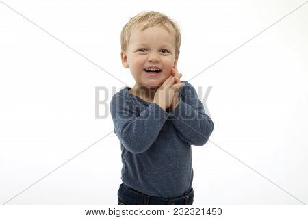 Excited Two Year Old Boy Looking At Something With Surprise And Joy. Studio Shot On White Background