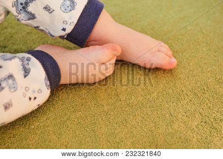 Beautiful Baby Legs On A Green Carpet