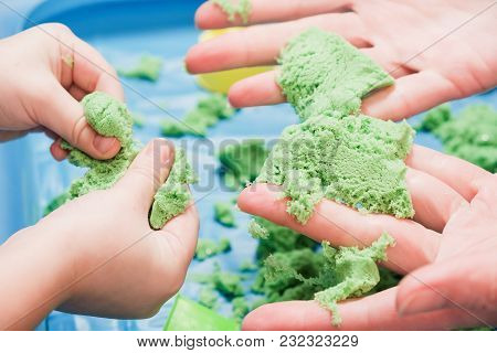 Children Playing Kinetic Colored Sand. Kids Games And Education In Family