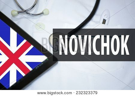 Medical Bathrobe, Tablet With English Flag And Inscription With Russian In Latin Transcription -