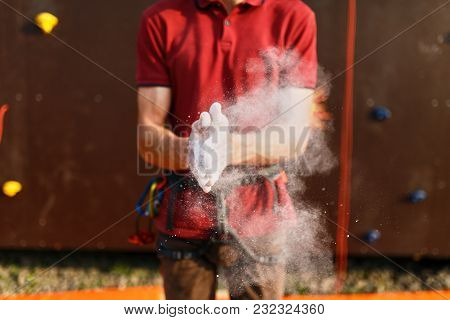 Close Up Of Climber Man Coating Hands In Powder Chalk Magnesium And Preparing To Climb Outdoor Train