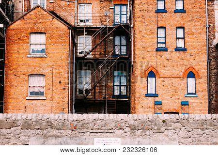 House Facade, Blue Windows And Yellow Brick, Fire Escape