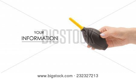 Female Hand Holding A Pear To Clean The Camera Pattern On A White Background Isolation