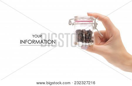Female Hand Holding A Jar With Spice Barberry Pattern On A White Background Isolation