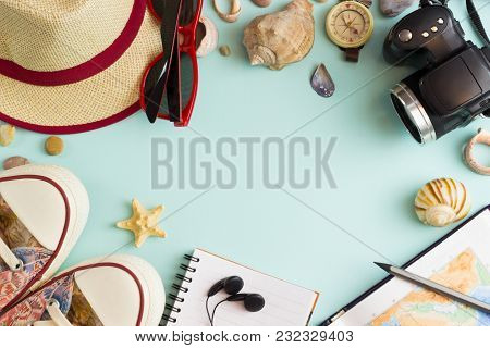 Vacation Concept With Travel Essentials, Sea Shells And Starfish On A Blue Background. Trendy Flat-l