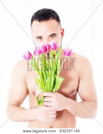 Man With Naked Torso Holding A Bunch Of Tulips