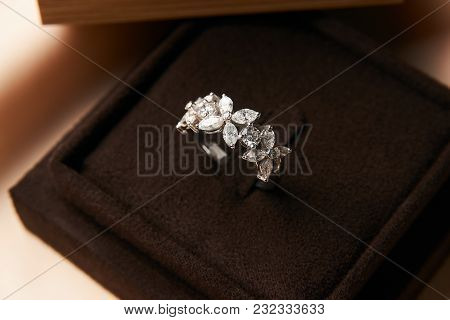 Diamond Ring In Dark Jewel Box. Close-up Of A Jewelry Box With Elegant Gold Ring With Brilliants, Sy