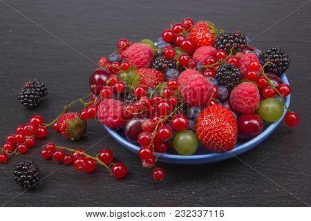 Various Summer Fresh Berries In A Bowl On Rustic Wooden Table. Antioxidants, Detox Diet, Organic Fru