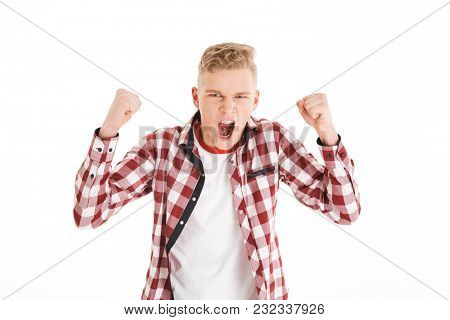 Portrait of an excited schoolboy celebrating success isolated over white background