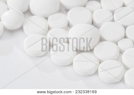 White Pills And Tablets Isolated On White Background Macro With Copy Space