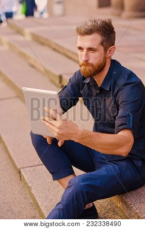 Handsome Bearded Male Tourist In Casual Clothes
