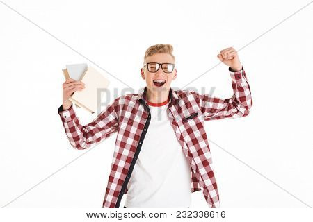 Portrait of a happy schoolboy celebrating success while holding money banknotes isolated over white background