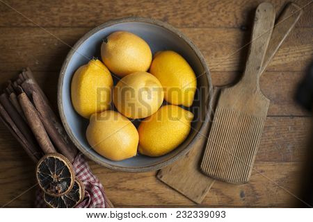 Bowl Of Lemons A A Wooden Surface