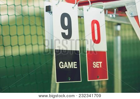 Scoreboard On Tennis Court During The Game Outdoor, Closeup. Sports Background