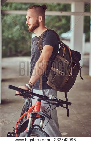Handsome Redhead Male With A Stylish Haircut And Beard Dressed In Casual Clothes With A Bicycle And