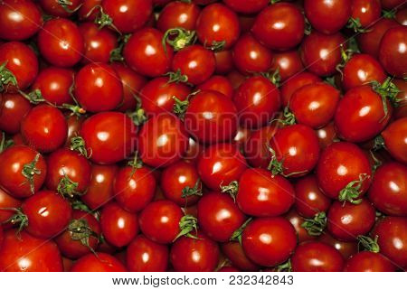 Background - Red Ripe Plum Tomatoes With Cuttings