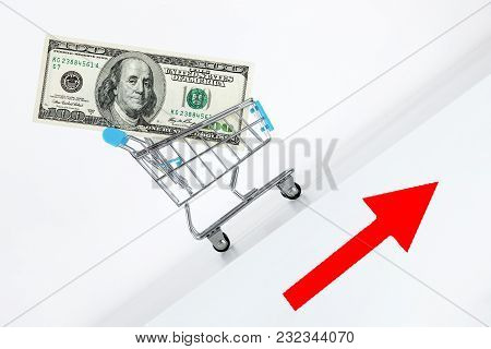 Hundred Dollar Bill In Cart. Rising Up Direction With Red Arrow Sign. Growth Of Wealth Concept. Grow